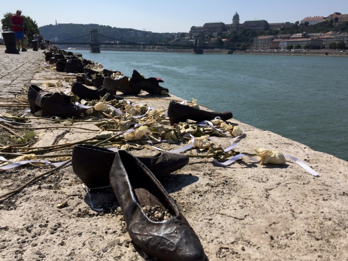 60 pairs of shoes laid out by the Danube River. The Nazis would bring people to this river, tell them to take off their shoes and walk across the solid icy river. Before they could cross, they would be shot at the back of their heads.