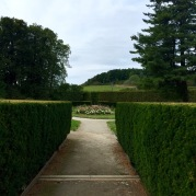 It leads to a ginormous garden with an open air theatre and a lake at the end of it.