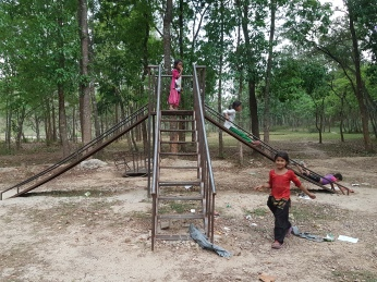 The playground outside the school.
